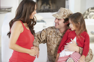 24447213 - family greeting military father home on leave